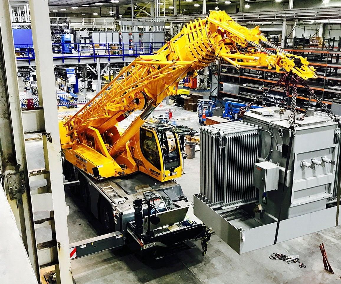 small crane inside warehouse
